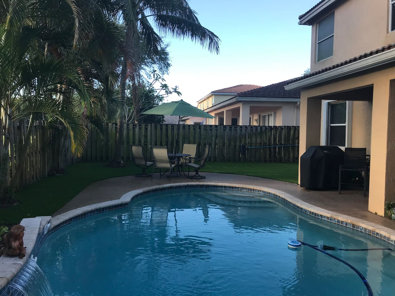 Enjoy your SoFlo stay with some quiet moments in the back yard, where you can take a dip in the pool, grill dinner and enjoy a meal and beverage on the back patio.