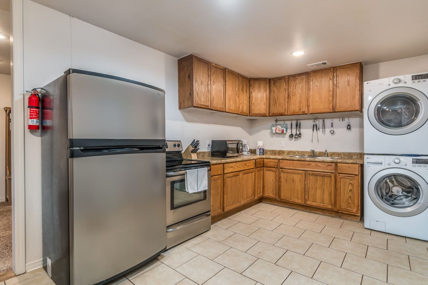Kitchen with full size appliances and washer/dryer.