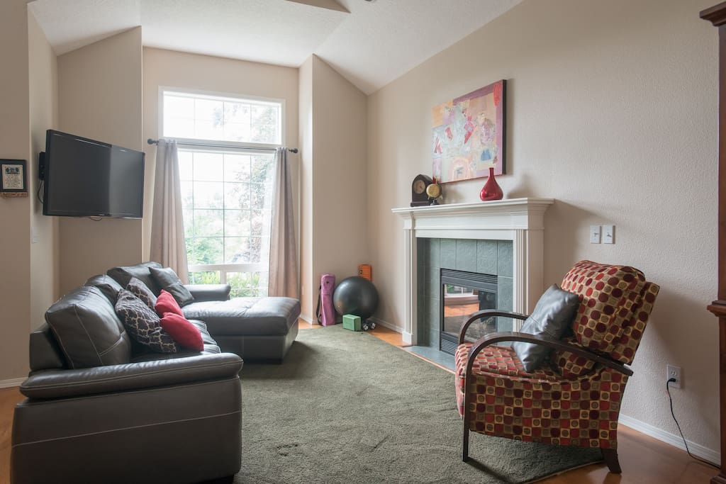 Curl up and socialize near the gas fireplace, or utilize some of the workout equipment (in the corner)