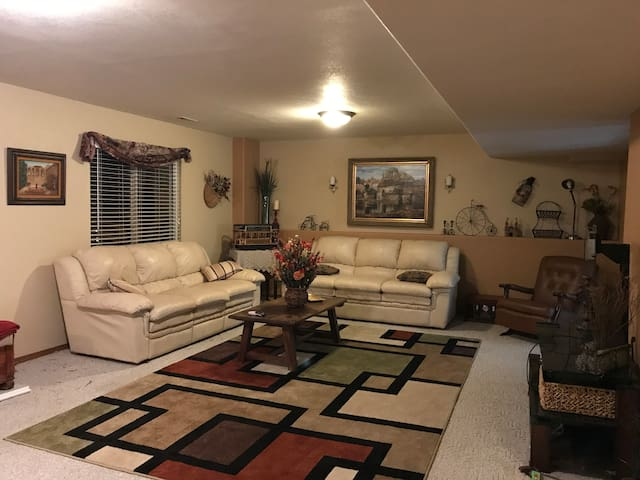 """large family room with 55"""" tv"""