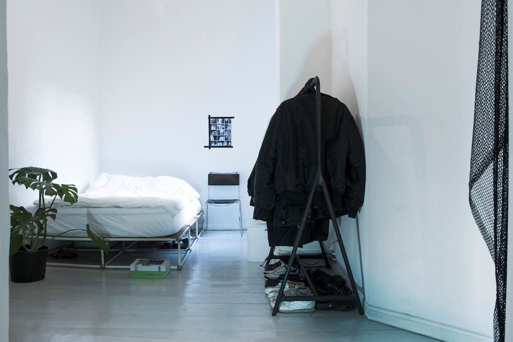 the bedroom with a thick double bed mattress (140 x 200 cm), clothes Rack and window to the yard.