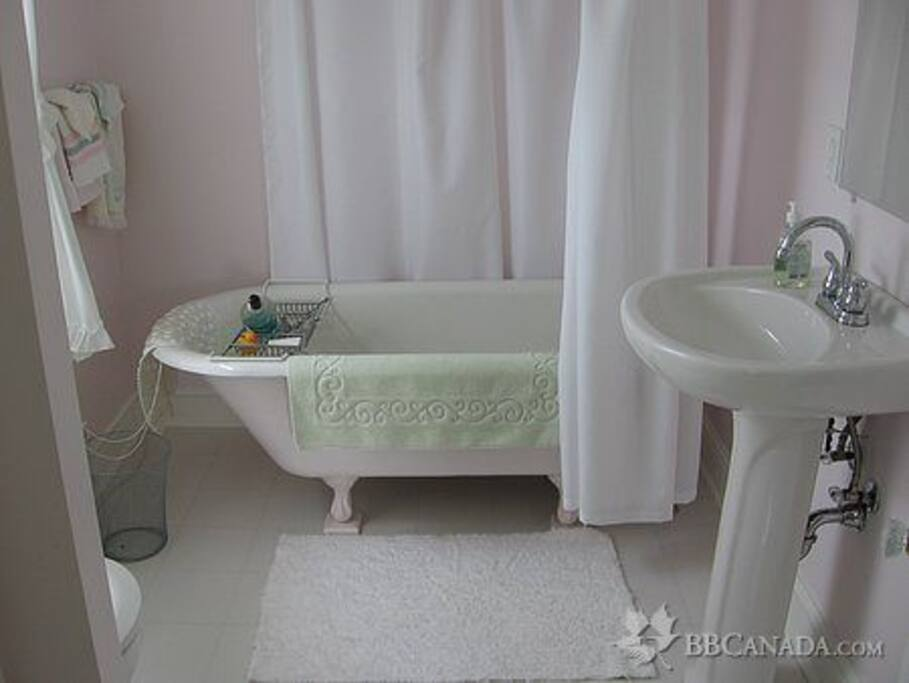 Bathroom with restored claw-foot tub and shower