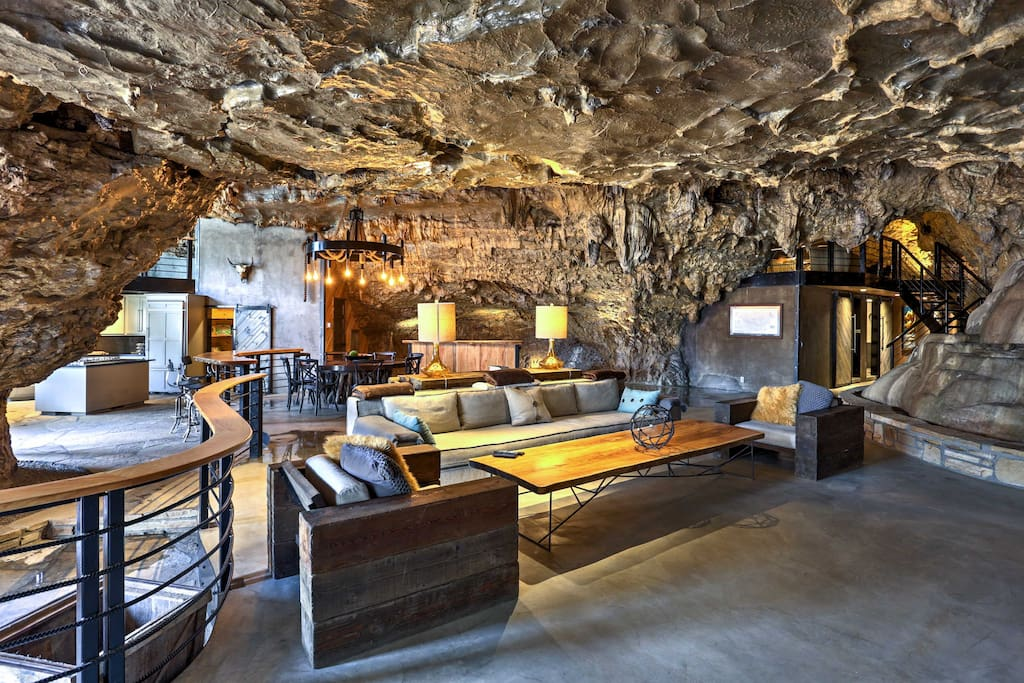 Admire cavern walls and stalactites  hanging from the ceiling while cozying up on living room couches.