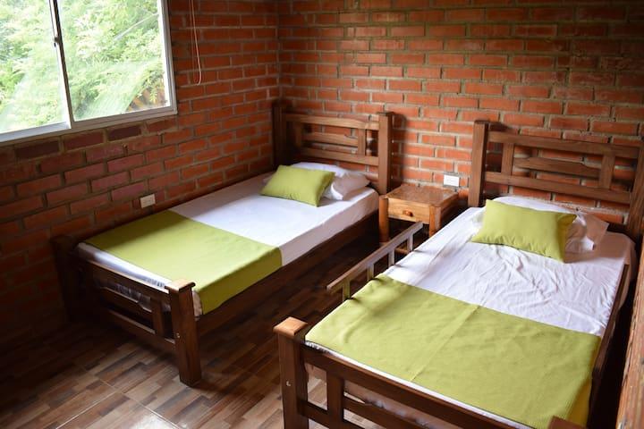 Habitación de cabaña en Minca cerca del pueblo.