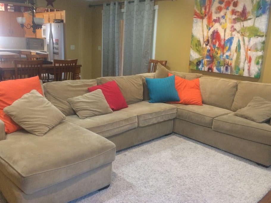 Large sectional with TV downstairs. Additional TV with gaming system upstairs.