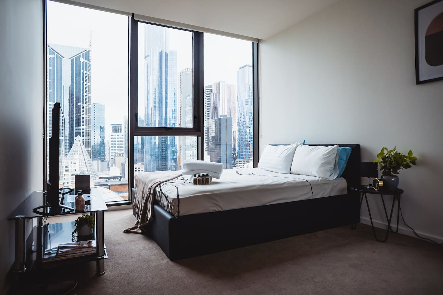 Spacious bedroom with queen bed, 50 inch Smart TV with Netflix, cabinets to store luggage and clothing, and amazing views of Melbourne City