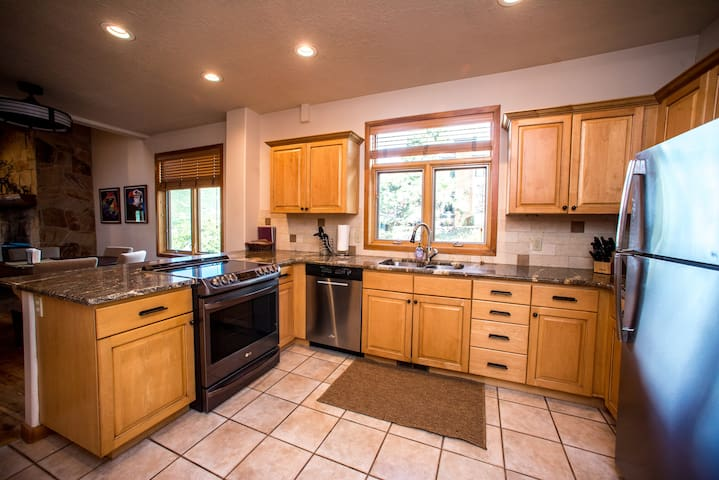 Spacious kitchen - comes stocked with spices, olive oil, flour, sugar, condiments!
