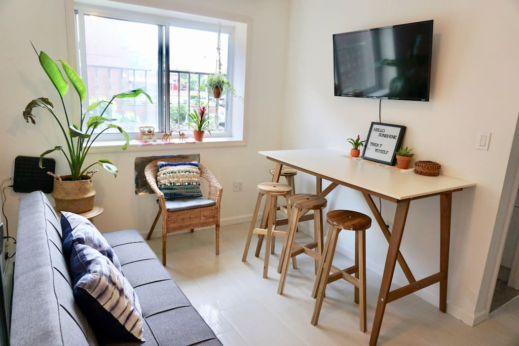 """Natural light fills living room and dining bar with 40"""" TV with free Netflix and 50+ channels"""