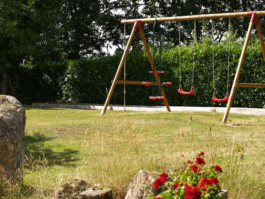 Swings set, with boules pitch in background.