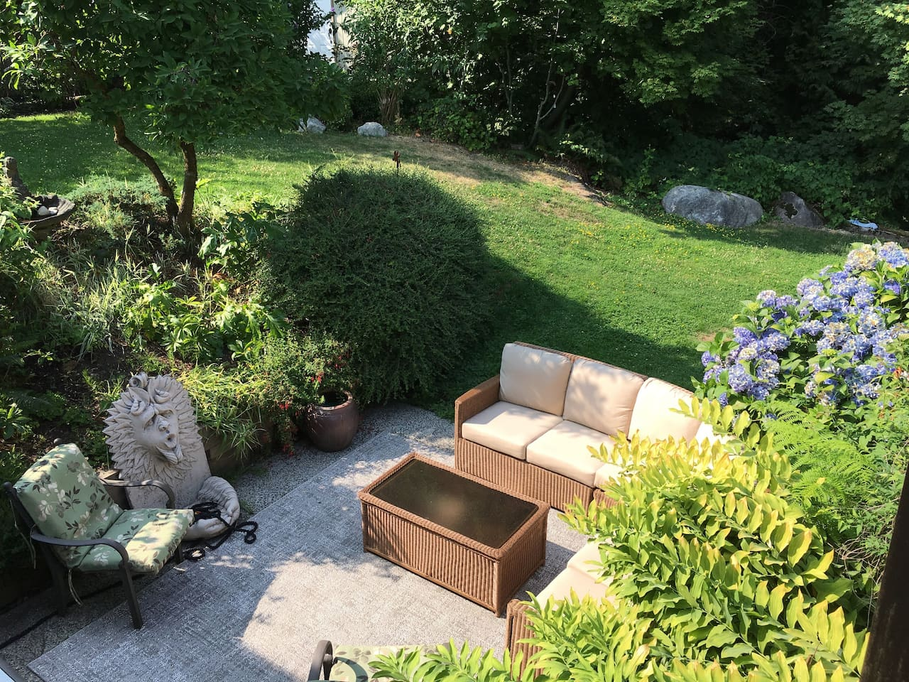 Very private yard to relax in. Overlooks beautiful garden & forest