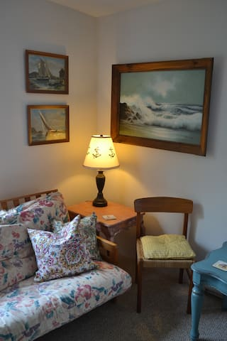 Cozy upstairs seating, ship viewing and double Futon pullout