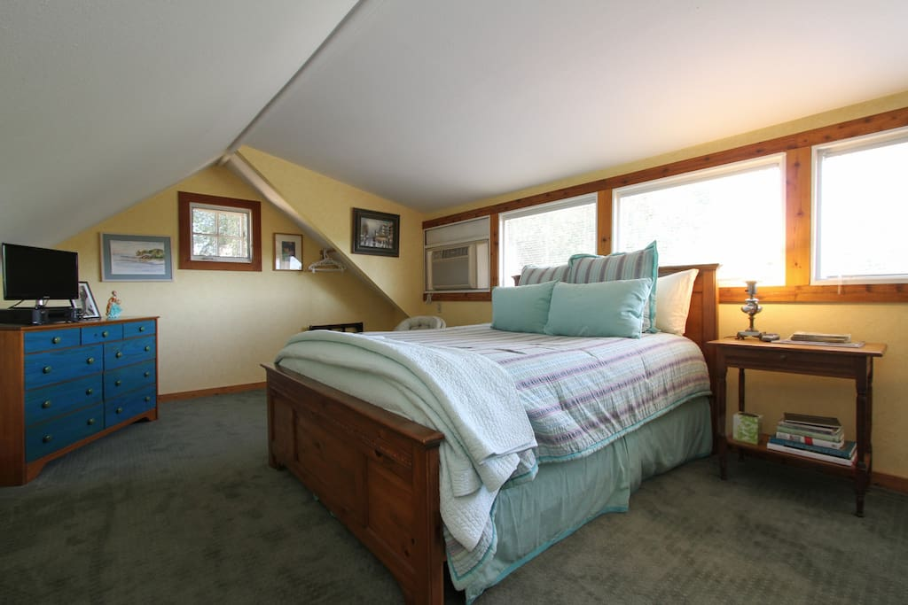 One of two bedrooms with queen bed