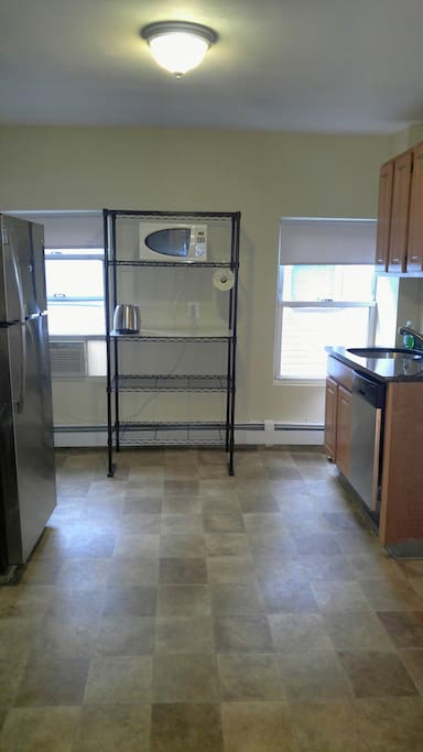 Kitchen equipped with refrigerator, stove, oven, microwave, dishwasher etc.