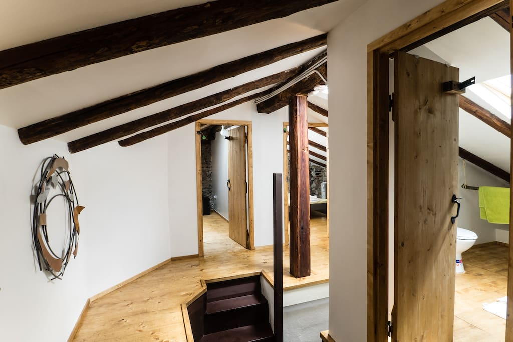 Stunning attic landing, with exposed beams and hand crafted doors