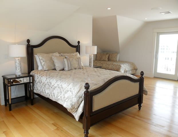 Bedroom with queen bed and twin, slider to deck, private bathroom