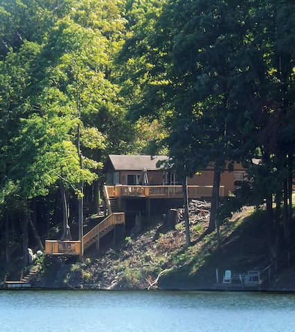 View of home with private deck overlooking Lake Charnita.