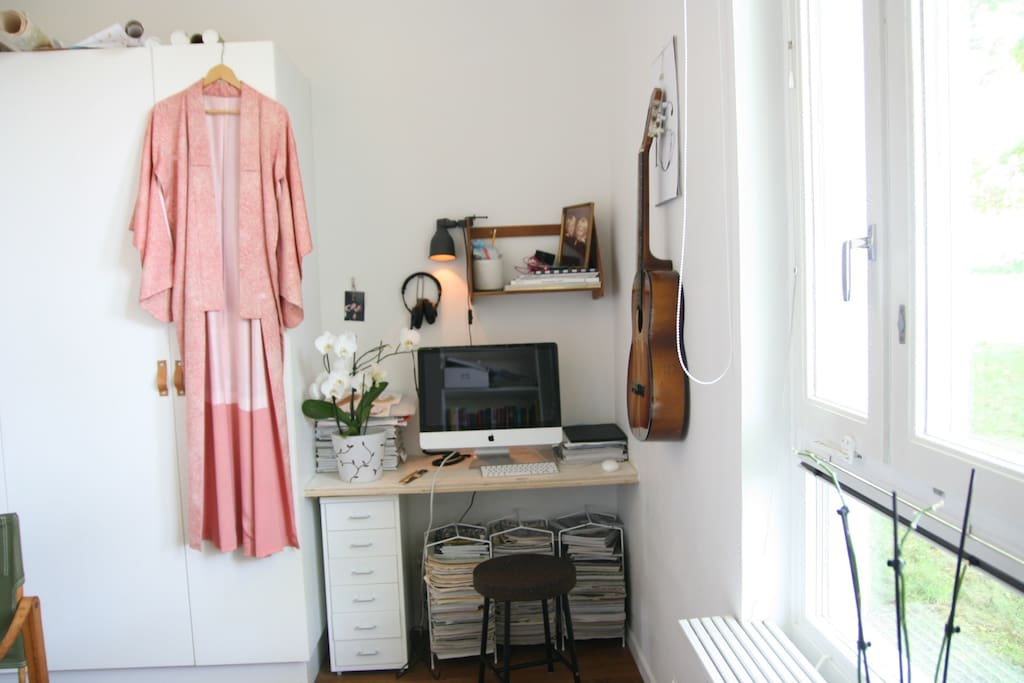 Bedroom 1 with computer and small workspace