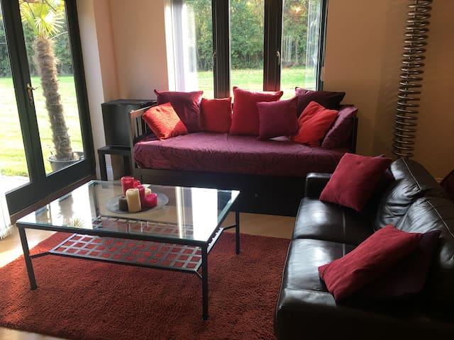 Lounge seating, fridge and gardens.