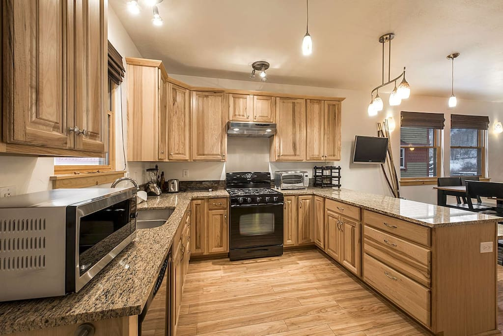 The full gourmet kitchen is spacious, renovated and bright and features all new household appliances, granite countertops, breakfast bar and balcony.