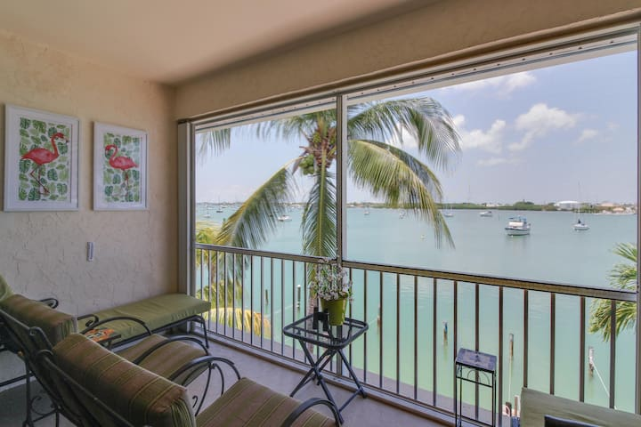 Waterfront home w/harbor views, shared pool, and available dock slip!