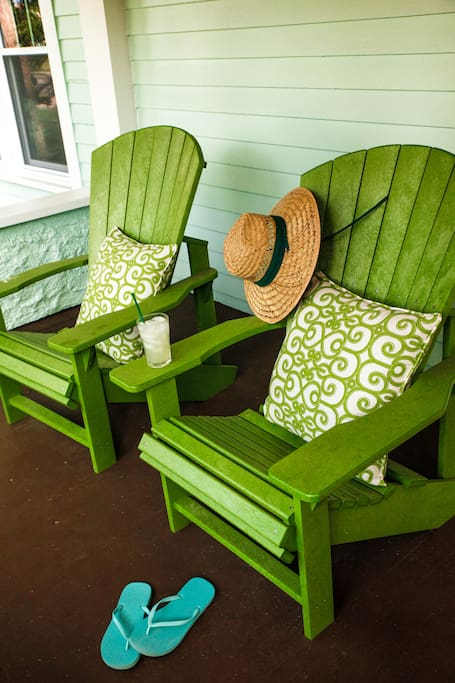Enjoy the view from the front porch from these comfy Adirondack chairs
