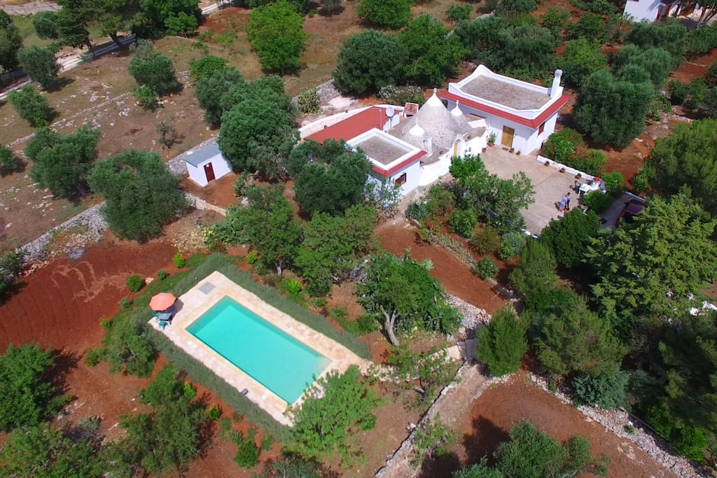 Aerial view of whole property with pool.