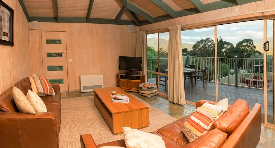 Expansive lounge with access to decking, outdoor dining and amazing views
