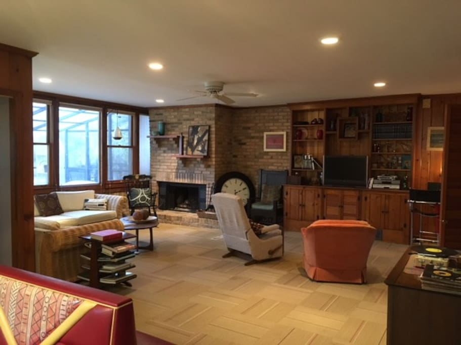 Family room, with working gas fireplace, and comfortable seating for entertaining.