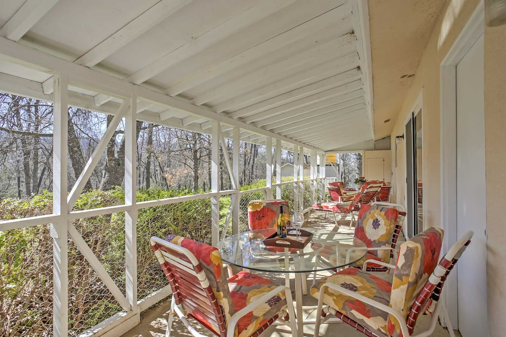 Sip morning coffee in the sun room as you overlook wooded views.