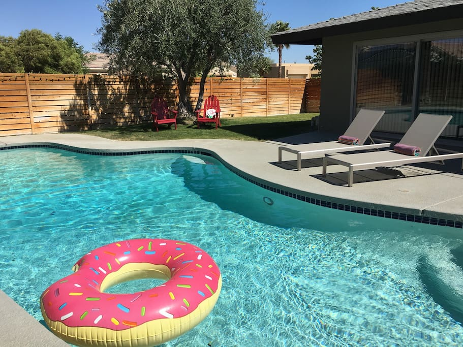 The house has several inflatable pool toys, four (4) lounge chairs, and four (4) Adirondack chairs.
