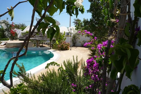 Oxala House: Bungalow Wassini. Mer et campagne