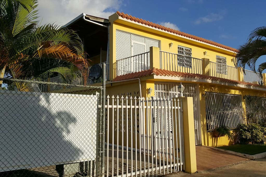 Outide corner view of The Bright Yellow House! Private parking gate, remote control gate.