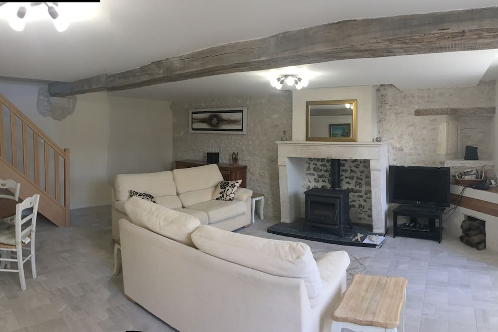 Lounge, dining area and log burner