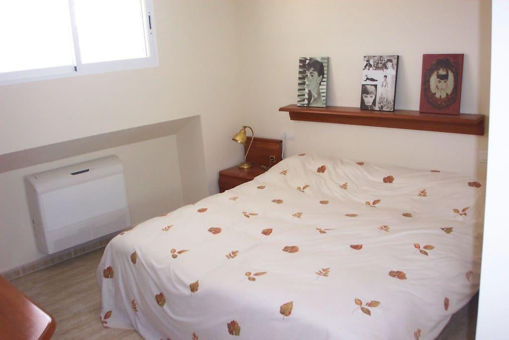 Dormitorio de matrimonio con 2 camas de 90 cm