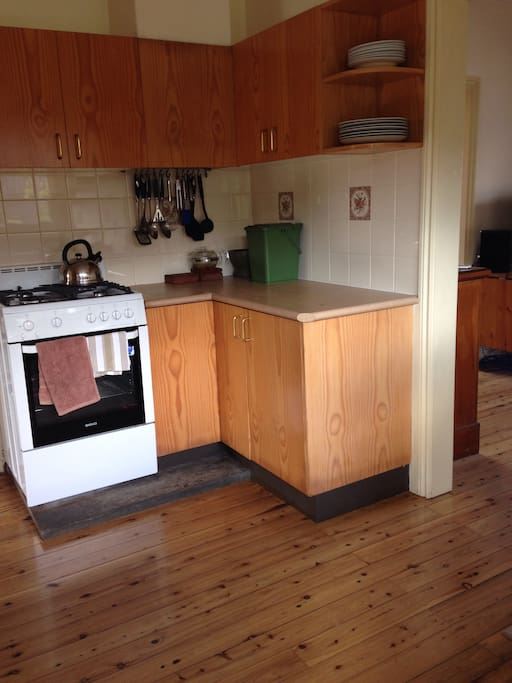 Gas stove. Original cedar floorboards throughout the house