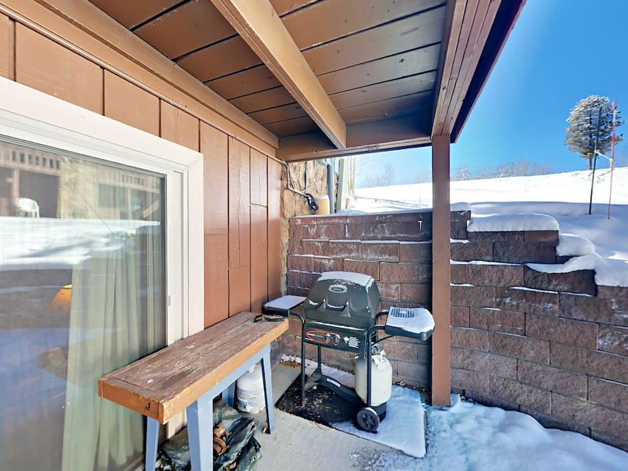 Make use of the gas grill on the back patio. There's also a stash of firewood for your convenience.