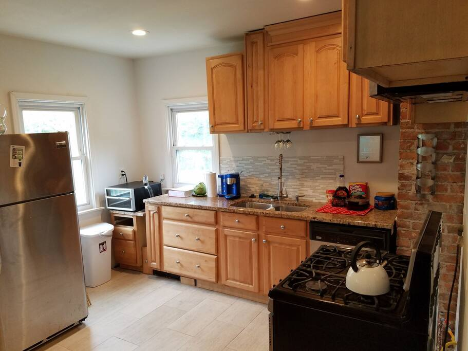 Our kitchen with all stainless steel appliances, wine chiller and decanter, coffee and breakfast station with waffle maker