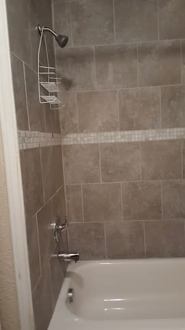 Here is the shower with bathtub.