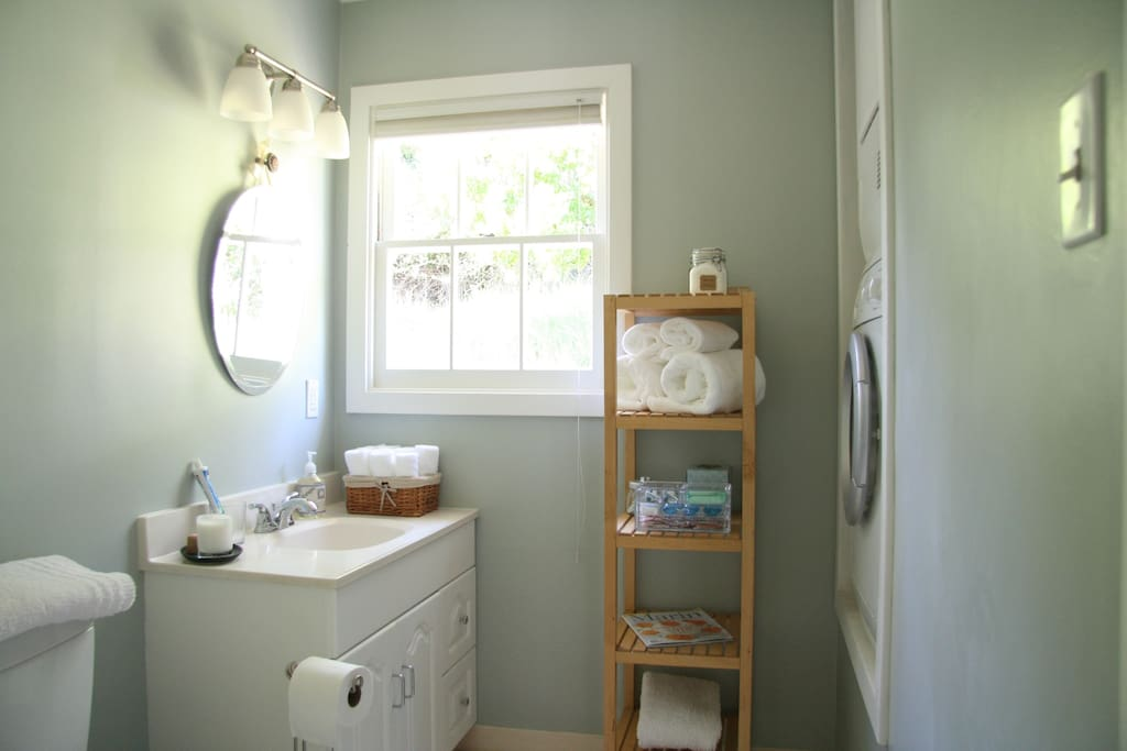 Bathroom with shower stall. Washer and dryer located in bathroom.