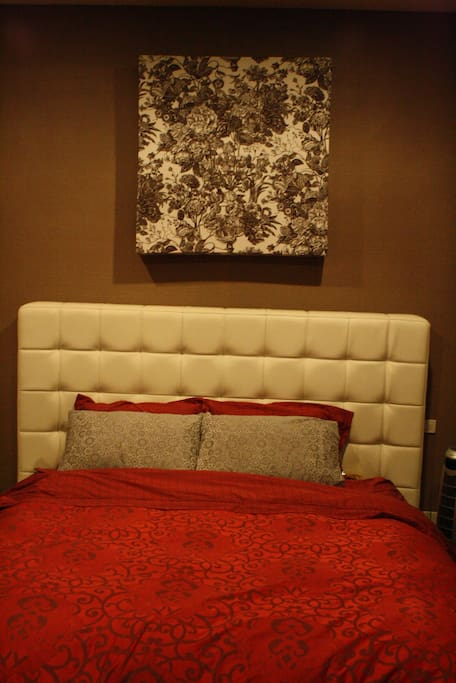 Master Bedroom with a king size bed can accommodate 2 guests. we use Omazz mattress for your extra comfort.