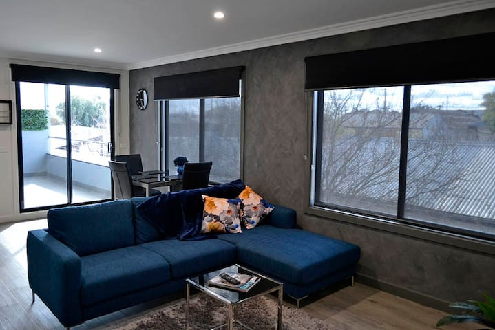 Living Area with access to private balcony