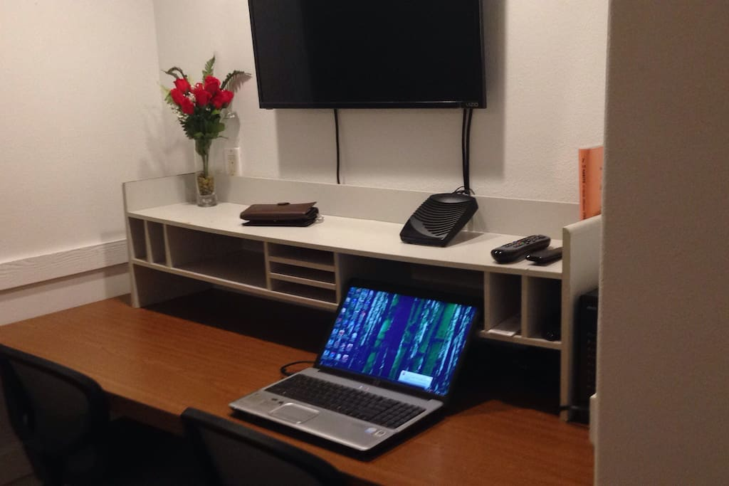 Business center with flat screen cable TV and Comcast High Speed Internet.
