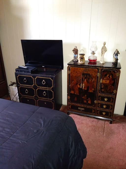 "Dresser with 32"" flat screen for use and decorative Oriental cabinet."