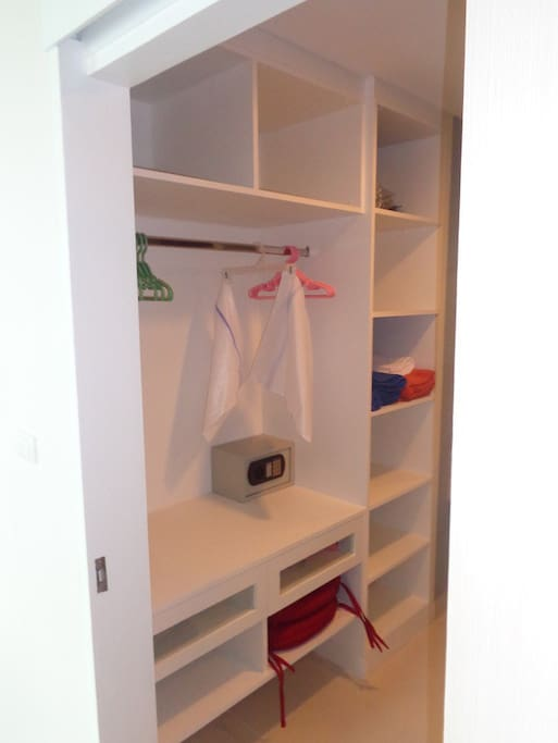 Closet with small safe.