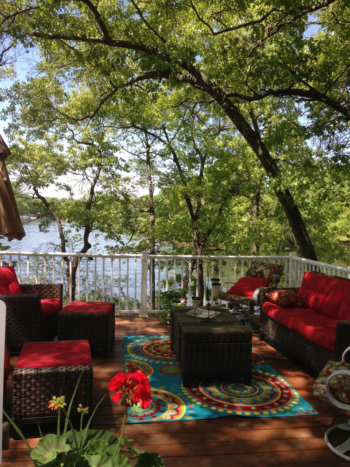 ... The deck sits under a canopy of trees and almost always has a light breeze that & Corner Cottage