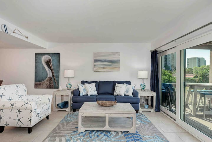 Living Room with water view.  New queen sofa bed with lift top coffee table