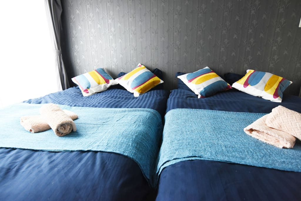 Simple and relaxing bedroom with 2 double beds