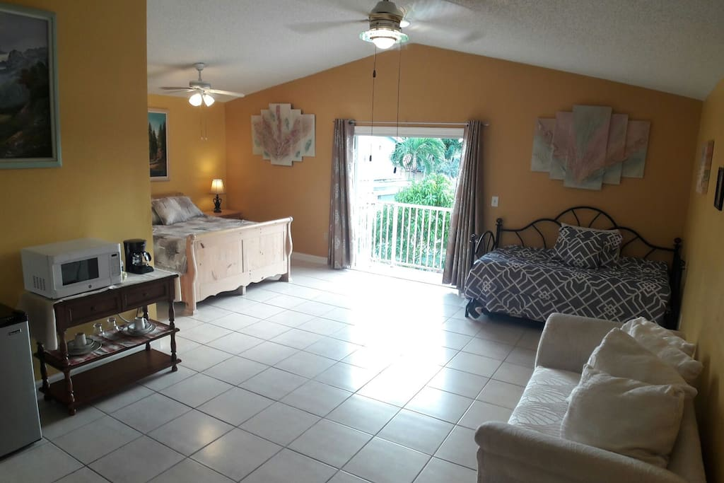 Enjoy your stay at this extra large Master Suite w/ private balcony and pool access. It is perfectly-sized for a couple, young family, or group of friends and is equipped with essential amenities, WiFi, refrigerator, microwave and coffee maker.