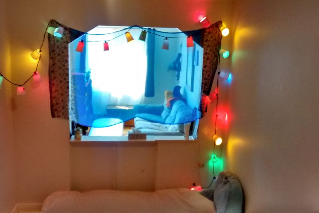 The bedroom now has a bed frame and full curtains.  A new picture will be uploaded soon.