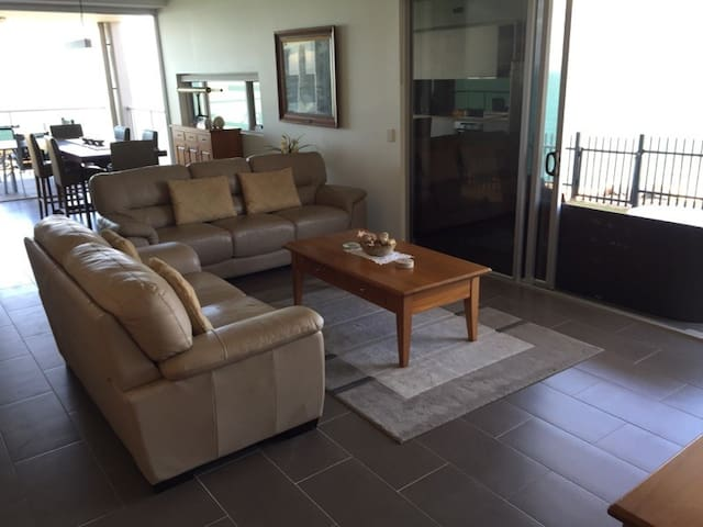 Comfortable lounge area with huge sliding glass doors on both water frontages